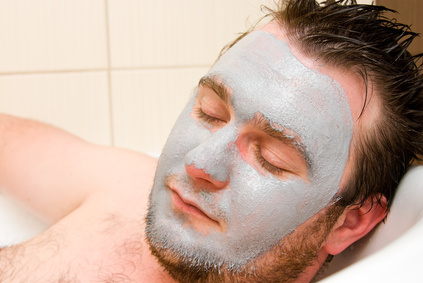 Man enjoying facial treatment